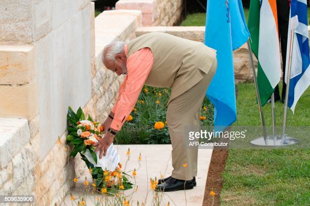 Indian Prime Minister Narendra Modi lays a wreath during a memorial ceremony at the Indian Army Cemetery of the World War I to honour fallen Indian...