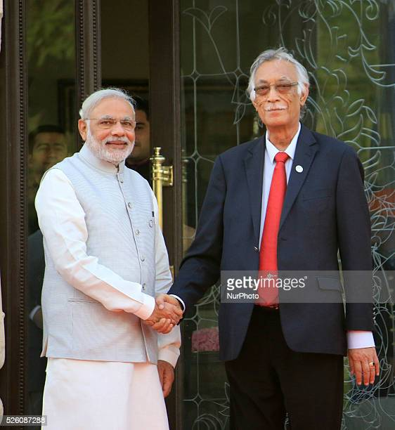 Indian Prime Minister Narendra Modi left Niue Prime Minister Toke Talagi hand shakes at the 2nd Summit of Forum for IndiaPacific Island Cooperation...