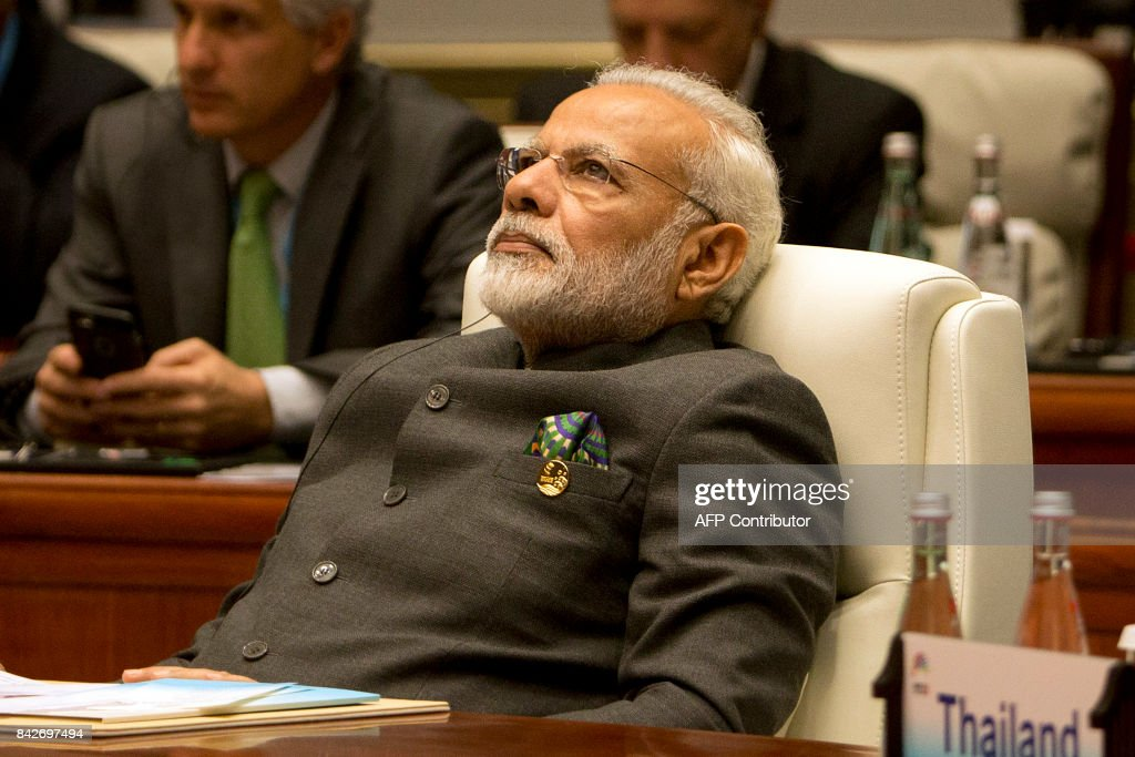 Indian Prime Minister Narendra Modi listens to a speech during the Dialogue of Emerging Market and Developing Countries on the sidelines of the 2017 BRICS Summit in Xiamen, southeastern China's Fujian Province on September 5, 2017. Xi opened the annual summit of BRICS leaders that already has been upstaged by North Korea's latest nuclear weapons provocation. / AFP PHOTO / POOL / Mark Schiefelbein