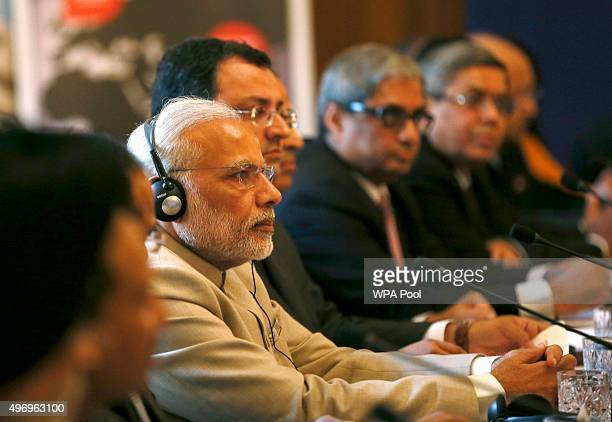 Indian Prime Minister Narendra Modi looks on during the CEO Forum with Prime Minister David Cameron at number 10 Downing Street on November 13 in...