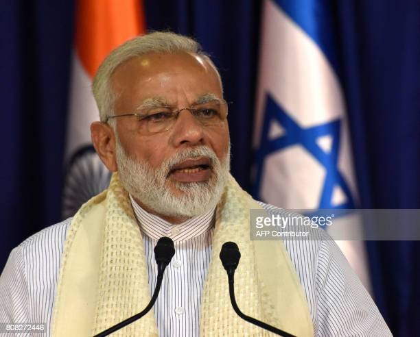 Indian Prime Minister Narendra Modi makes a joint statement with his Israeli counterpart on July 4 at the laters residence in Jerusalem / AFP PHOTO /...