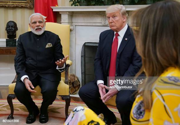 Indian Prime Minister Narendra Modi meets with US President Donald Trump and First Lady Melania Trump at the White House in Washington DC on June 26...