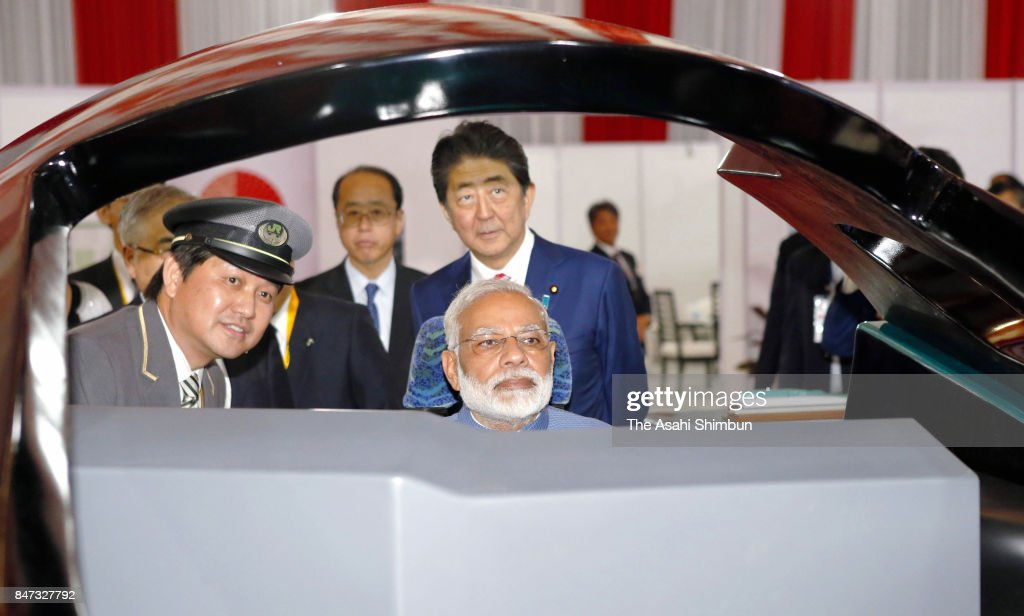 Indian Prime Minister Narendra Modi operates a high speed train simulator in the driving seat while Japanese Prime Minister Shinzo Abe watches during their inspection of the high-speed train simulator on September 14, 2017 in Gandhinagar, India. Abe is on 2-day tour in India.