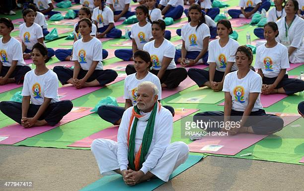 Indian Prime Minister Narendra Modi participates in a mass yoga session along with other Indian yoga practitioners to mark the International Yoga Day...