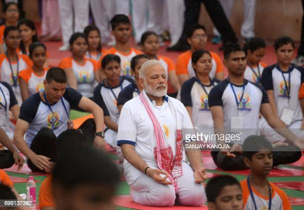 Indian Prime Minister Narendra Modi participates in a mass yoga session along with other Indian yoga practitioners to mark the 3rd International Yoga...
