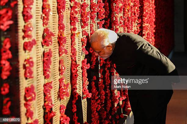 Indian Prime Minister Narendra Modi places a poppy on the wall at the Australian War Memorial Australian Prime Minister Tony Abbott on November 18...