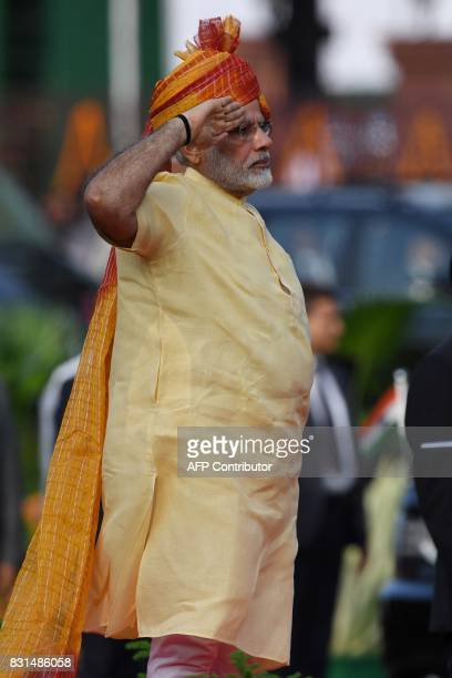 Indian Prime Minister Narendra Modi salutes a guard of honour during the country's 71st Independence Day celebrations which marks the 70th...