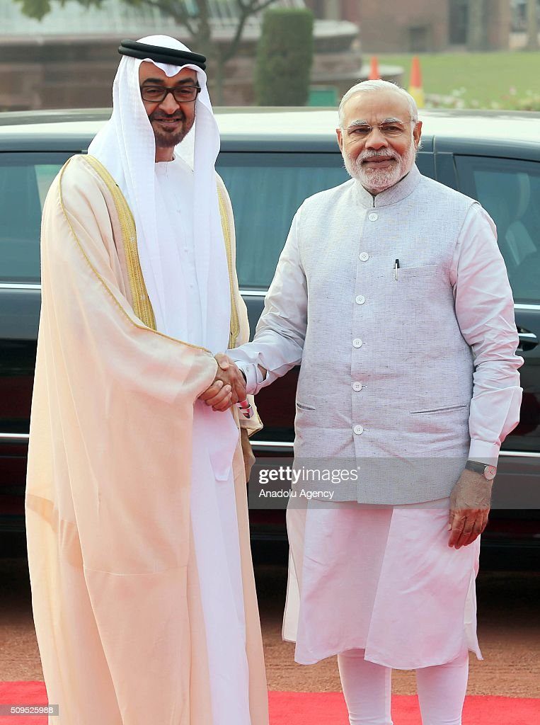 Indian Prime Minister Narendra Modi (R), shakes hand with Abu Dhabi's Crown Prince Sheikh Mohammed bin Zayed Al Nahyan (L) on his arrival at the Indian presidential palace for A ceremonial reception, in New Delhi, India on February 11, 2016. Nahyan is on a three-day visit to India.