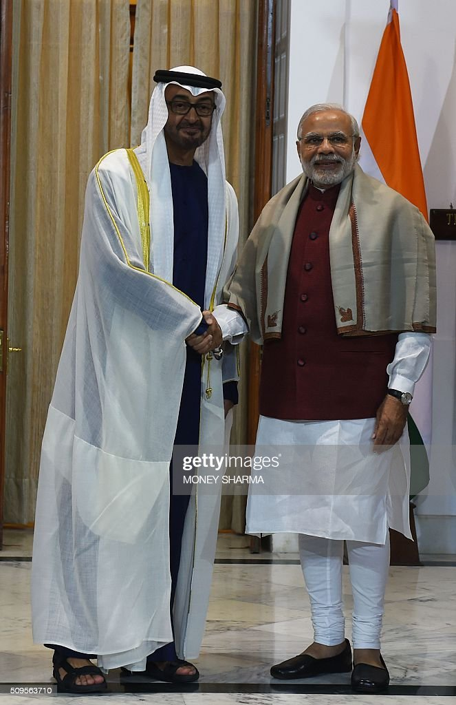 Indian Prime Minister Narendra Modi (R) shakes hand with Abu Dhabi's Crown Prince Sheikh Mohammed bin Zayed al-Nahyan at Hyderabad House in New Delhi on February 11, 2016. The crown prince is on a three-day state visit to India until February 12. AFP PHOTO / Money SHARMA / AFP / MONEY SHARMA