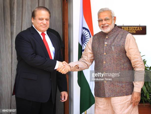 Indian Prime Minister Narendra Modi shakes hand with his Pakistani counterpart Nawaz Sharif before the start of their bilateral meeting at Hyderabad...