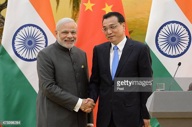 Indian Prime Minister Narendra Modi shakes hands with Chinese Premier Li Keqiang after a press conference at the Great Hall of the People on May 15...