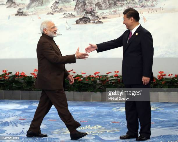 Indian Prime Minister Narendra Modi shakes hands with Chinese President Xi Jinping prior to the dinner on September 4 2017 in Xiamen China Leaders of...