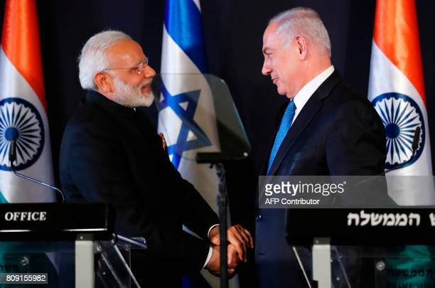 Indian Prime Minister Narendra Modi shakes hands with his Israeli counterpart Benjamin Netanyahu during a press conference in Jerusalem on July 5...