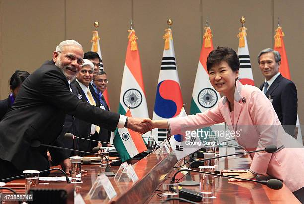 Indian Prime Minister Narendra Modi shakes hands with South Korean President Park GeunHye during a meeting at the presidential Blue House on May 18...