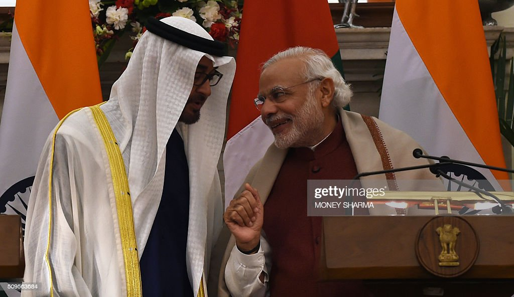 Indian Prime Minister Narendra Modi (R) shares a light moment with Abu Dhabi's Crown Prince Sheikh Mohammed bin Zayed al-Nahyan at Hyderabad House in New Delhi on February 11, 2016. The crown prince is on a three-day state visit to India until February 12. AFP PHOTO / Money SHARMA / AFP / MONEY SHARMA