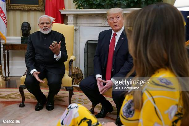Indian Prime Minister Narendra Modi speaks during a meeting with US President Donald Trump and First Lady Melania Trump at the White House in...