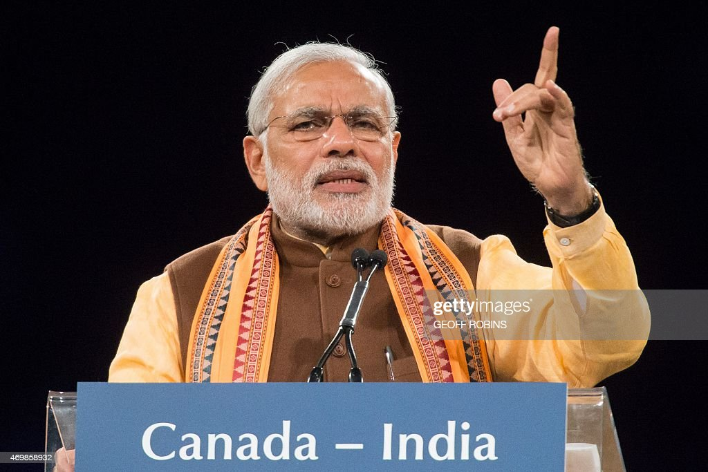 Indian Prime Minister <a gi-track='captionPersonalityLinkClicked' href=/galleries/search?phrase=Narendra+Modi&family=editorial&specificpeople=822611 ng-click='$event.stopPropagation()'>Narendra Modi</a> speaks to a crowd during a rally on Prime Minister Modi's first official visit to Canada, April 15, 2015 in Toronto. AFP PHOTO / GEOFF ROBINS