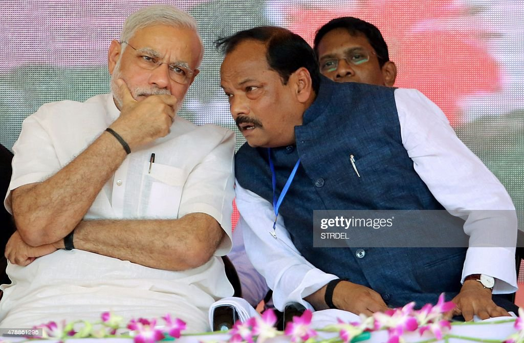 Indian Prime Minister Narendra Modi speaks with Chief Minister of the eastern Indian state of Jharkhand Raghubar Das at an inauguration ceremony of...