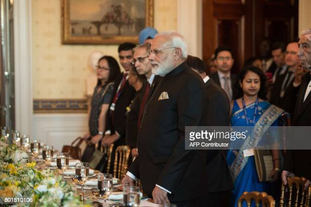 Indian Prime Minister Narendra Modi takes his seat in the Blue Room for dinner with US President Donald Trump and First Lady Melania Trump at the...