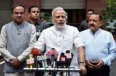 Indian Prime Minister Narendra Modi talks to the media with his cabinet colleagues after his arrival at the opening day of the Monsoon Session of the...