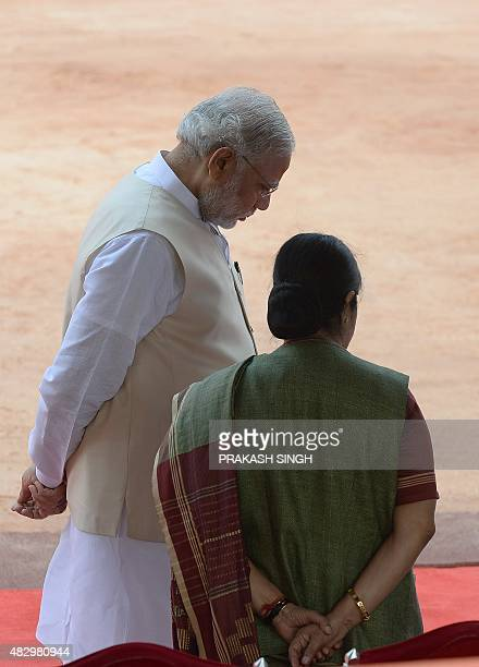 Indian Prime Minister Narendra Modi talks with Foreign Minister Sushma Swaraj while waiting for a ceremonial reception for Mozambique President...