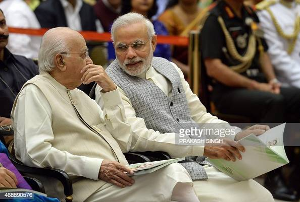 Indian Prime Minister Narendra Modi talks with senior Bhartiya Janta Party leader L K Advani during a Civil Investiture Ceremony at Rashtrapati...