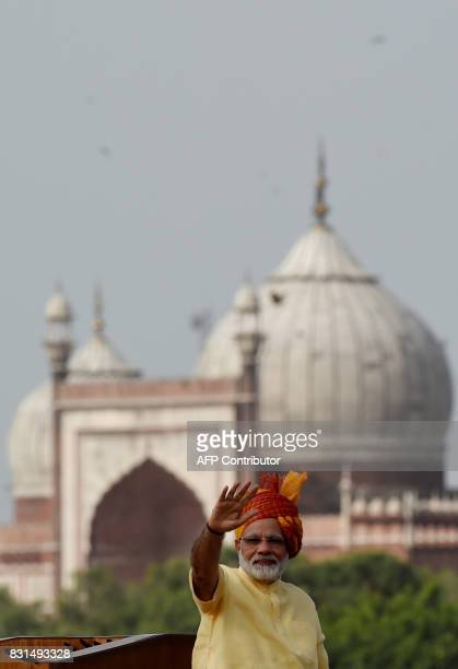 Indian Prime Minister Narendra Modi waves after delivering his speech for the country's 71st Independence Day celebrations which marks the 70th...