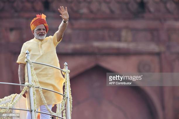 Indian Prime Minister Narendra Modi waves following his address during the country's 71st Independence Day celebrations which marks the 70th...