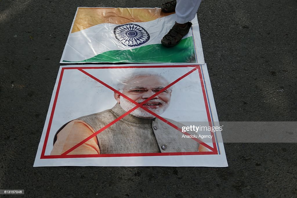 Indian Prime Minister Narendra Modi's portrait is seen on the ground as Muslim Students Organization members stage a protest against the tension between Pakistan and India in the Kashmir region, in Islamabad, Pakistan on October 7, 2016. Since 1989, Kashmiri resistance groups in the IHK have fought against Indian rule for independence, or for unification with neighboring Pakistan. More than 70,000 victims have been so far reportedly killed in the conflict, most by the Indian armed forces. India maintains more than 500,000 troops in the disputed regions.