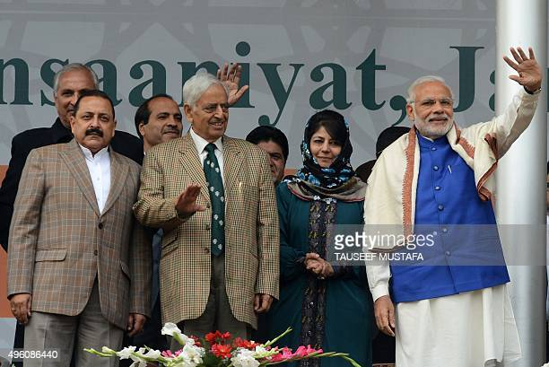 Indian Prime Minister Narindra Modi Peoples Democratic Party Mehbooba Mufty Jammu and Kashmir Chief Minister Mufty Muhammed Sayeed greet supporters...