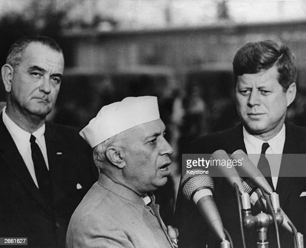 Indian Prime Minister Nehru speaking on his arrival at the White House watched by President John F Kennedy and Vice President Lyndon Baines Johnson