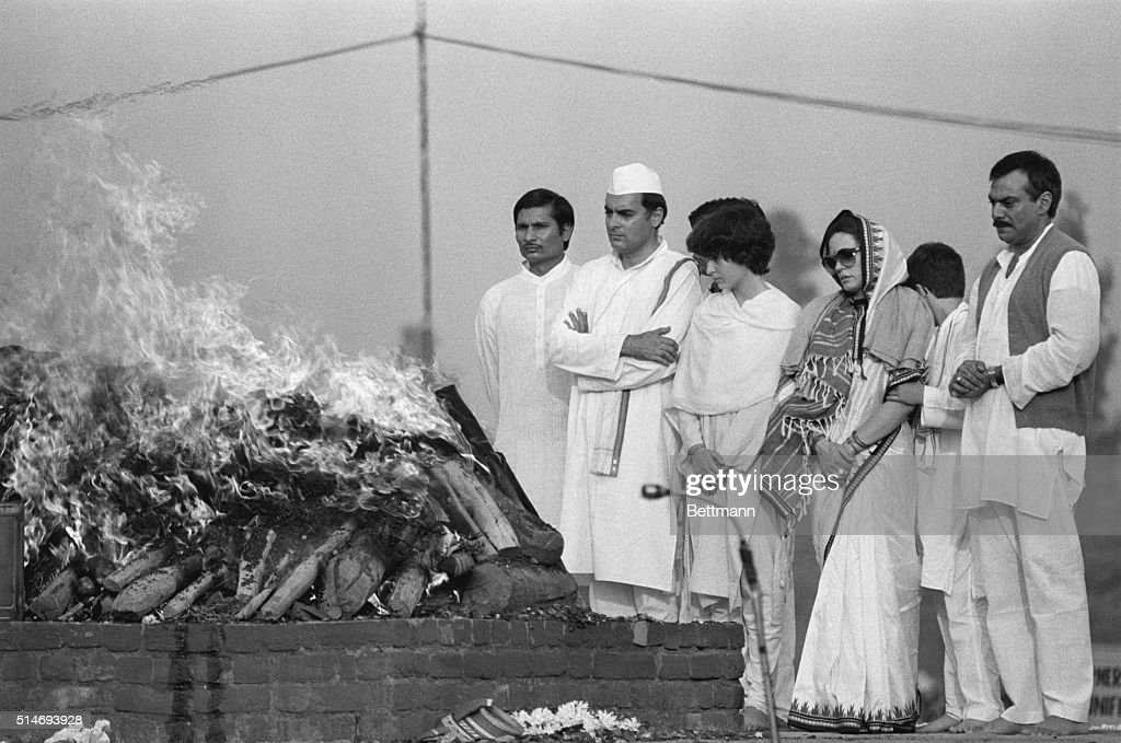 Indian Prime Minister Rajiv Gandhi, accompanied by his wife Sonia and his daughter Priyanka, attends the cremation of his mother, former Prime Minister Indira Gandhi.