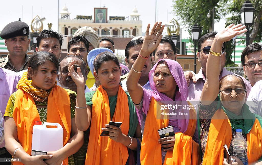 Indian prisoner in Pakistan Sarabjit Singh's sister Dalbir Kaur along with wife Sukhpreet and daughters Swapandeep Kaur and Poonam carries the container of holy water of Sarover of Harmandar Sahib (Golden Temple) for Sarabjit as crossing over to Pakistan at India-Pakistan Attari border on April 28, 2013 near Amritsar, India. Pakistani doctors treating a comatose Sarabjit Singh here today said there has been no improvement in his condition and chances of survival are slim even as his distraught family visited him and demanded that he be sent to India for better treatment. Sarabjit was admitted to the state-run Jinnah Hospital with a severe head injury after being attacked by prisoners. Sarabjit was convicted for alleged involvement in a string of bomb attacks in Punjab province that killed 14 people in 1990.