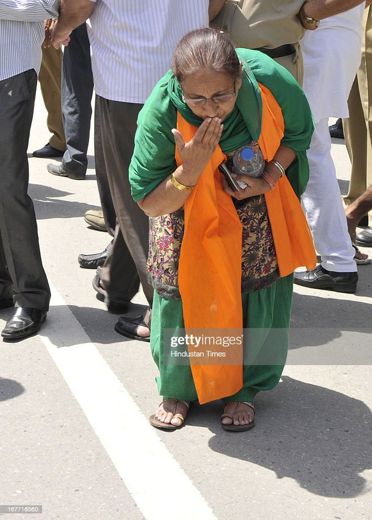 Indian prisoner in Pakistan Sarabjit Singh's sister Dalbir Kaur touching the Indian land before crossing over to Pakistan at India-Pakistan Attari border on April 28, 2013 near Amritsar, India. Pakistani doctors treating a comatose Sarabjit Singh today said there has been no improvement in his condition and chances of his survival are slim even as his distraught family visited him and demanded that he be sent to India for better treatment. Sarabjit was admitted to the state-run Jinnah Hospital with a severe head injury after being attacked by prisoners. Sarabjit was convicted for alleged involvement in a string of bomb attacks in Punjab province that killed 14 people in 1990.