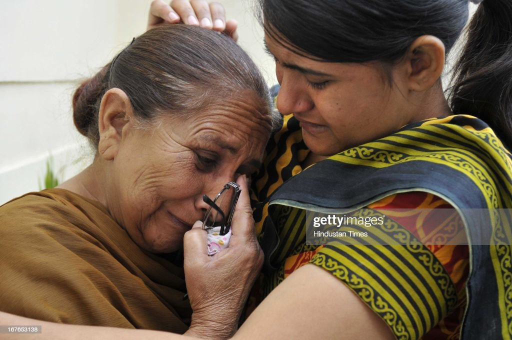 Indian prisoner Sarabjit's family shocked after getting a attack news on Sarabjit Singh in Pakistani Jail, his elder daughter consoling Sarabjit' sister Dalbir Kaur (R), who is in tears as worrying about his health, on April 27, 2013 in Amritsar, India. Sarabjit's family going to apply Pakistani Visa to meet Sarabjit in Pakistani hospital. According to the source, Sarabjit was hit on the head with bricks and his neck and stomach were cut with blades. Sarabjit was admitted to the state-run Jinnah Hospital with a severe head injury on Friday evening. Sarabjit was convicted for alleged involvement in a string of bomb attacks in Punjab province that killed 14 people in 1990.