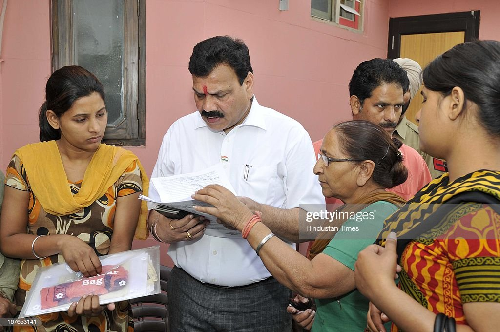 Indian prisoner Sarabjit's sister Dalbir Kaur handing over passports of her family to Indian SC Commission Vice President Dr. Raj Kumar Verka for applying Pakistani Visa on April 27, 2013 in Amritsar, India. Sarabjit's family going to apply Pakistani Visa to meet Sarabjit in Pakistani hospital. According to the source, Sarabjit was hit on the head with bricks and his neck and stomach were cut with blades. Sarabjit was admitted to the state-run Jinnah Hospital with a severe head injury on Friday evening. Sarabjit was convicted for alleged involvement in a string of bomb attacks in Punjab province that killed 14 people in 1990.