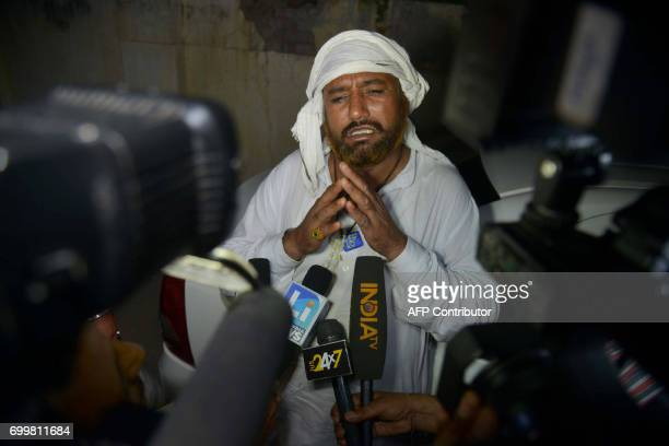 Indian prisoner Sohan Lal speaks to the media upon arriving at a Red Cross House after being released by Pakistani authorities in Amritsar on June 22...