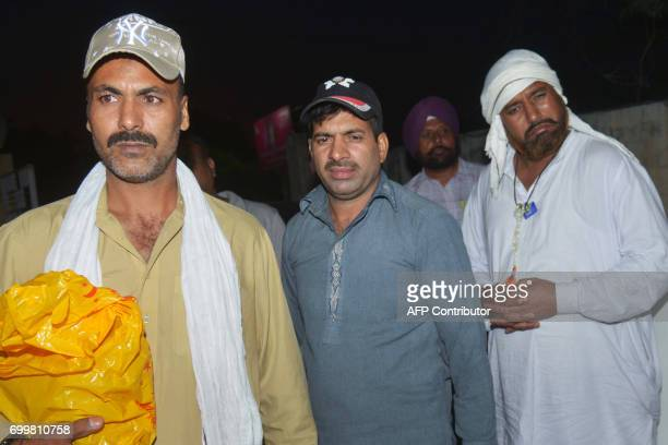 Indian prisoners Sohan Lal Abdul Majid and Mohammed Maqbool arrive at a Red Cross House after being released by Pakistani authorities in Amritsar on...