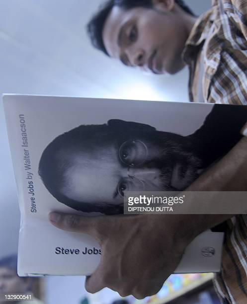 Indian prospective buyer reads the new biography of Apple cofounder Steve Jobs at Siliguri Book fair in Siliguri on November 15 2011 The eagerly...