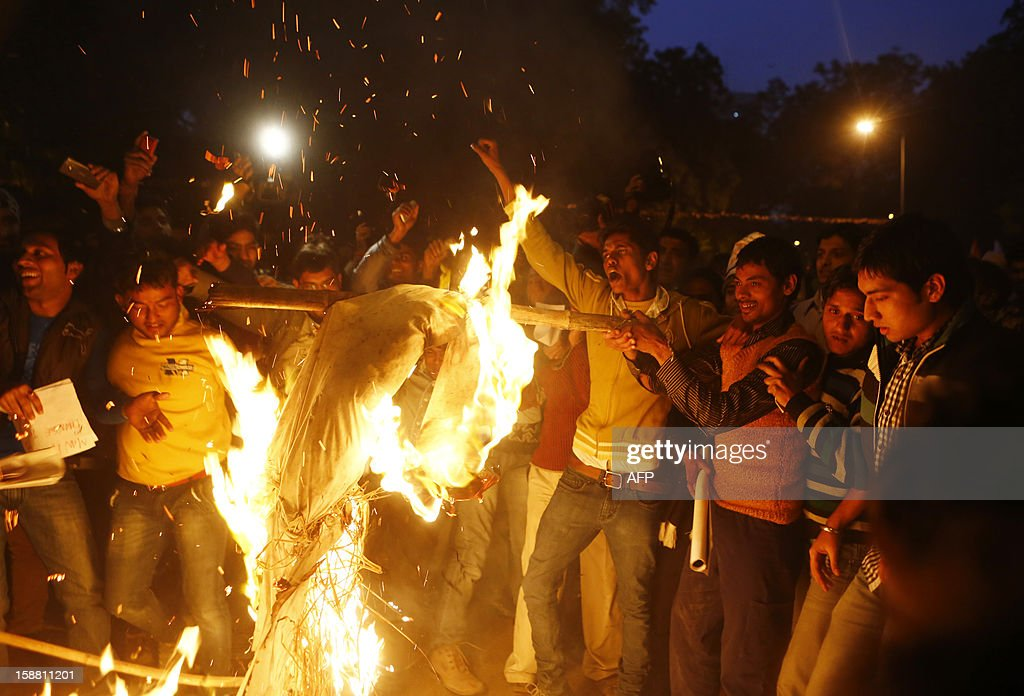 Indian protesters burn an effigy depicting rapists during a rally in New Delhi on December 30, 2012, following the cremation of a gangrape victim in the Indian capital. The victim of a gang-rape and murder which triggered an outpouring of grief and anger across India was cremated at a private ceremony, hours after her body was flown home from Singapore. A student of 23-year-old, the focus of nationwide protests since she was brutally attacked on a bus in New Delhi two weeks ago, was cremated away from the public glare at the request of her traumatised parents. AFP PHOTO/ ANDREW CABALLERO-REYNOLDS