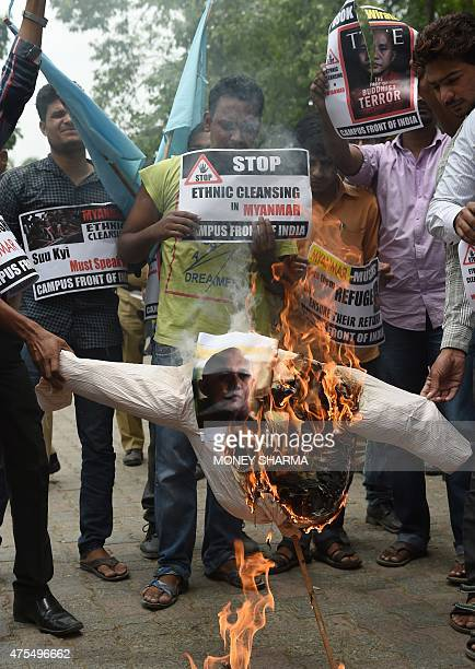 Indian protesters burn an effigy of Ashin Wirathu a hardline Buddhist monk in Myanmar as they rally in support of Rohingya Muslims in Myanmar during...