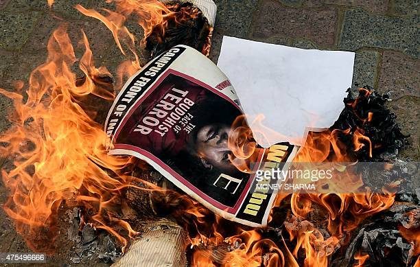 Indian protesters burn the image Ashin Wirathu a hardline Buddhist monk in Myanmar as they rally in support of Rohingya Muslims in Myanmar during a...