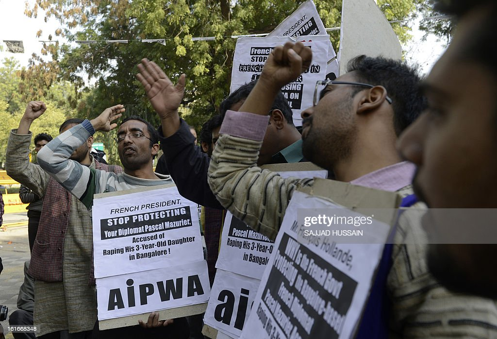 Indian protesters demonstrate during the visit of French President Francois Hollande in New Delhi on February 14, 2013. The demonstrators protested against the French government's protection of a French diplomat accused of raping his three-year-old daughter, and against the proposed construction of a nuclear power plant at Jaitapur in Maharashtra state.