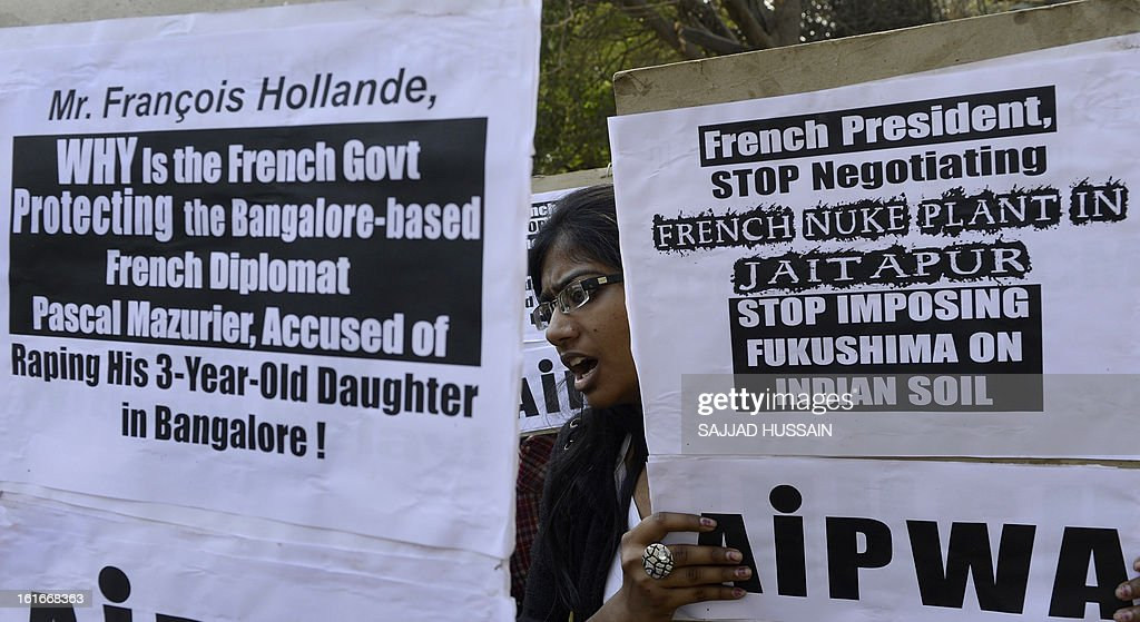 Indian protesters demonstrate during the visit of French President Francois Hollande in New Delhi on February 14, 2013. The demonstrators protested against the French government's protection of a French diplomat accused of raping his three-year-old daughter, and against the proposed construction of a nuclear power plant at Jaitapur in Maharashtra state. AFP PHOTO/ SAJJAD HUSSAIN
