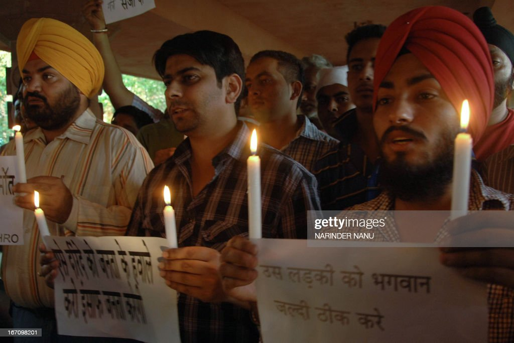 Indian protesters from International Human Rights Organisation holds candles during a demonstration in Amritsar on April 20, 2013, against the rape of a five-year old girl in New Delhi. A five-year-old Indian girl who was abducted, repeatedly raped and tortured in New Delhi was on Saturday alert and in a stable condition but may need surgery, her doctors said.