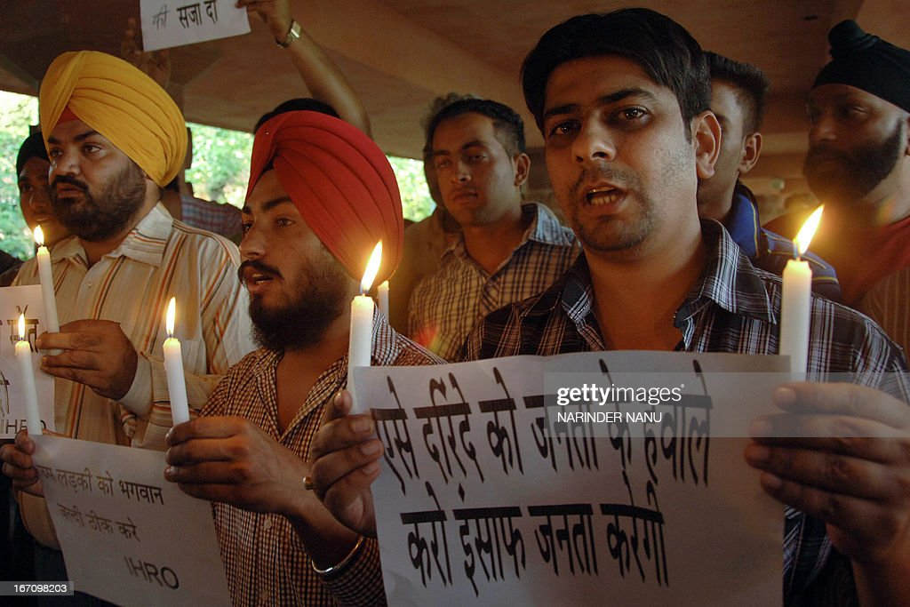 Indian protesters from International Human Rights Organisation holds candles during a demonstration in Amritsar on April 20, 2013, against the rape of a five-year old girl in New Delhi. A five-year-old Indian girl who was abducted, repeatedly raped and tortured in New Delhi was on Saturday alert and in a stable condition but may need surgery, her doctors said. AFP PHOTO /NARINDER NANU