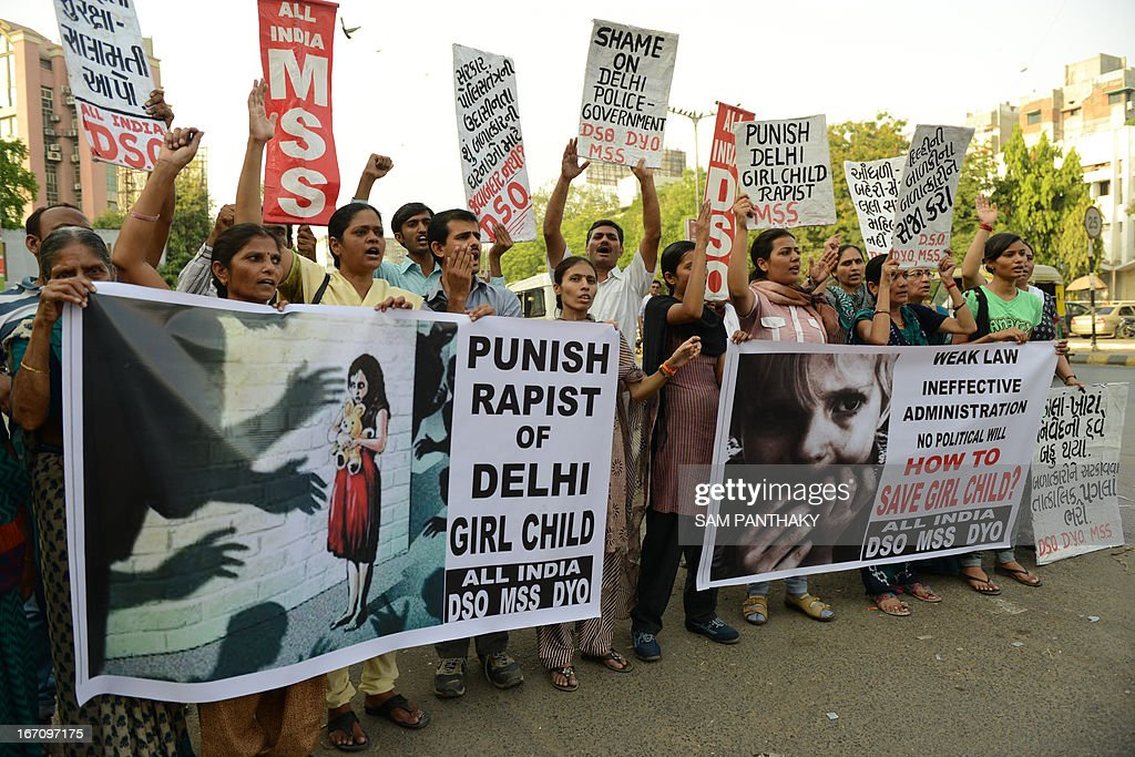 Indian protesters from the All-India Democratic Students Organisation and All-India Mahila Sanskritik Students Organisation demonstrate in Ahmedabad on April 20, 2013, against the brutal rape of a five-year old girl in New Delhi. A five-year-old Indian girl who was abducted, repeatedly raped and tortured in New Delhi was on Saturday alert and in a stable condition but may need surgery, her doctors said. AFP PHOTO / Sam PANTHAKY
