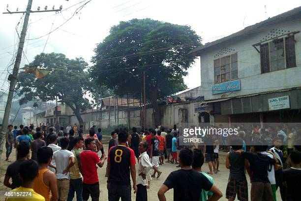 Indian protesters gather during violence in the Churachandpur district of the state of Manipur on September 1 2015 Hundreds of protesters clashed...