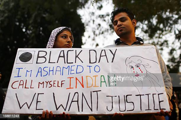 Indian protesters hold a placard during a rally in New Delhi on December 30 following the cremation of a gangrape victim in the Indian capital The...