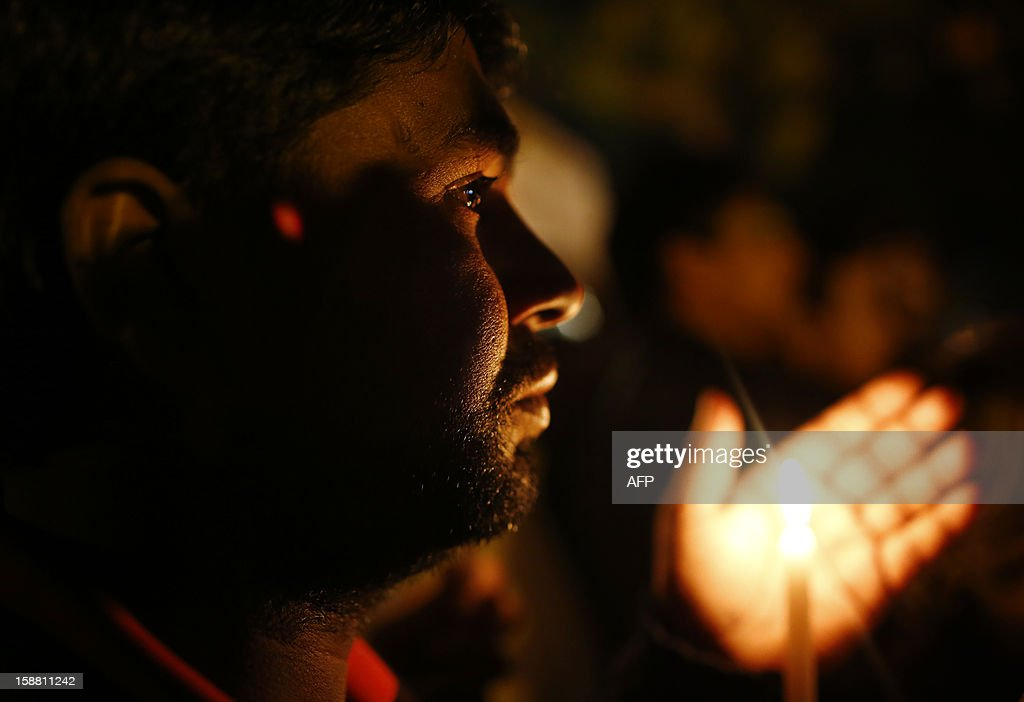 Indian protesters hold candles during a rally in New Delhi on December 30, 2012, following the cremation of a gangrape victim in the Indian capital. The victim of a gang-rape and murder which triggered an outpouring of grief and anger across India was cremated at a private ceremony, hours after her body was flown home from Singapore. A student of 23-year-old, the focus of nationwide protests since she was brutally attacked on a bus in New Delhi two weeks ago, was cremated away from the public glare at the request of her traumatised parents.